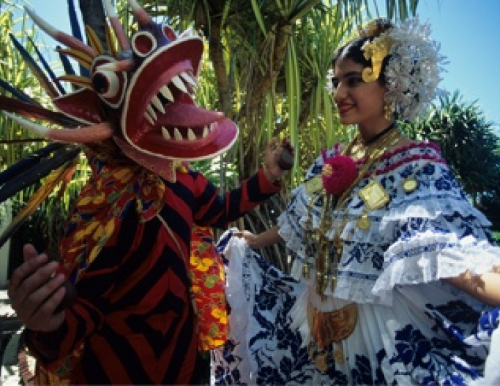 A diablico dancer and a woman in a pollera, Panama's national dress