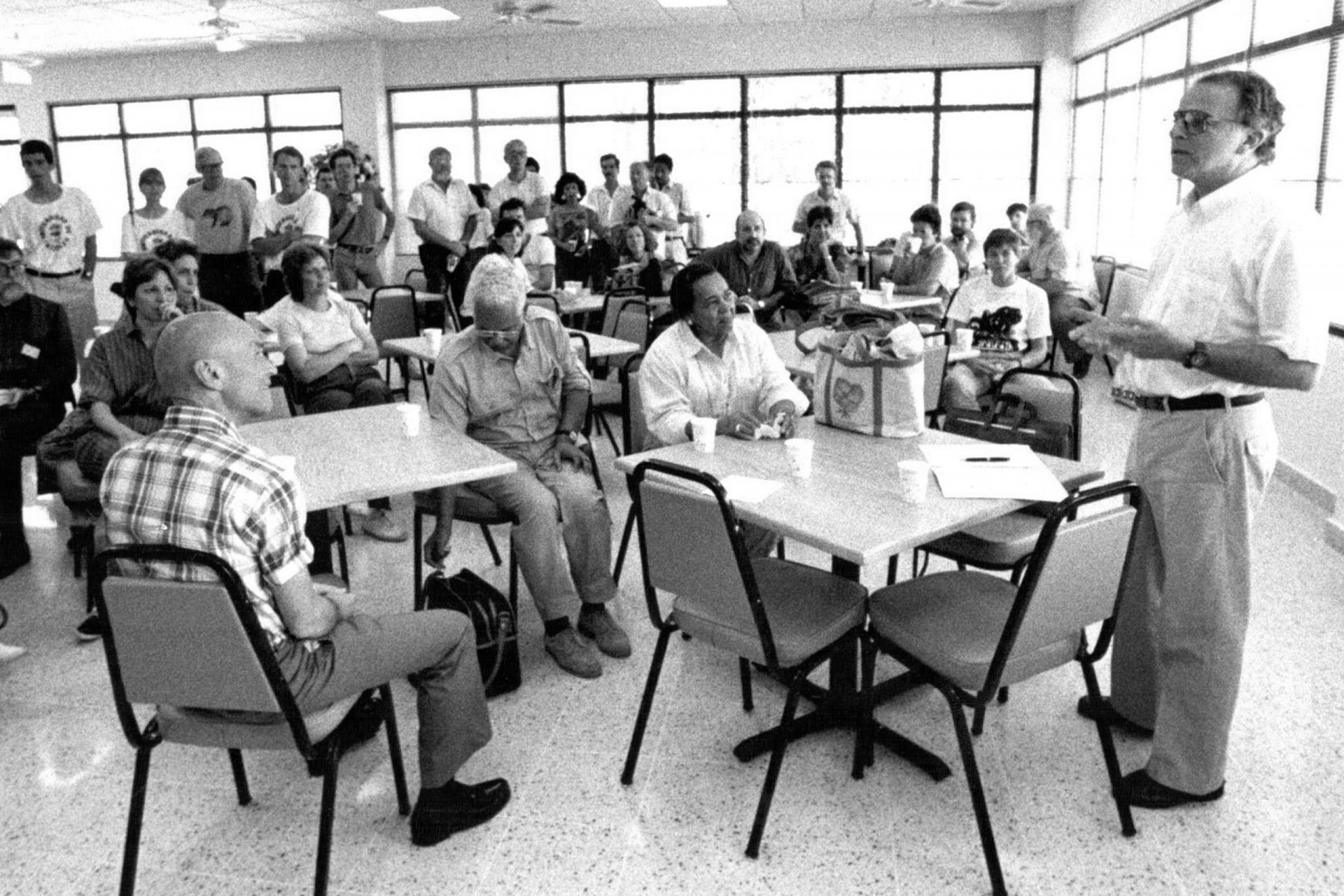 Ira Rubinoff, right, speaks in the dining room at Barro Colorado Island