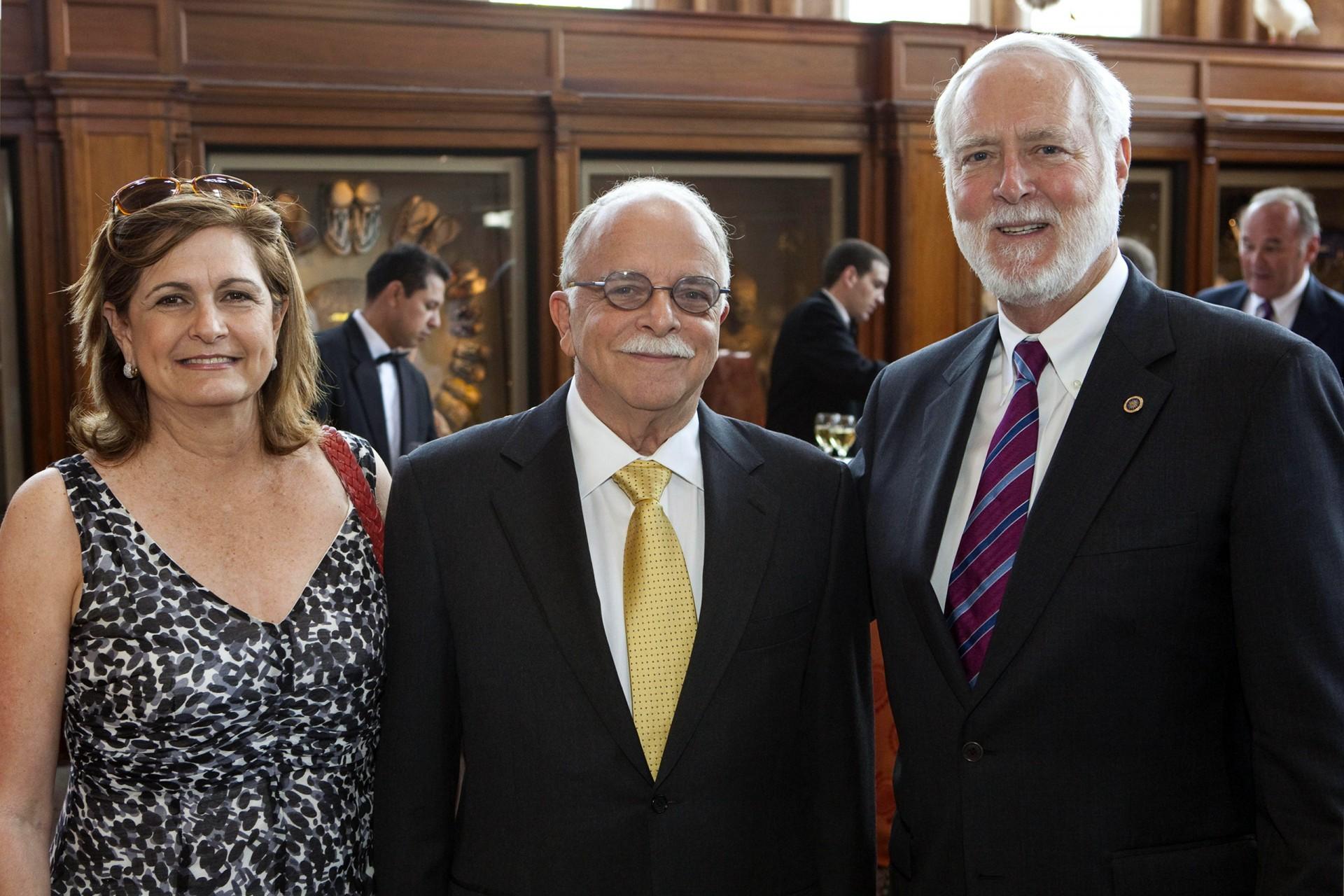 Ira Rubinoff, center, with his wife Anabella and Smithsonian Secretary Wayne Clough