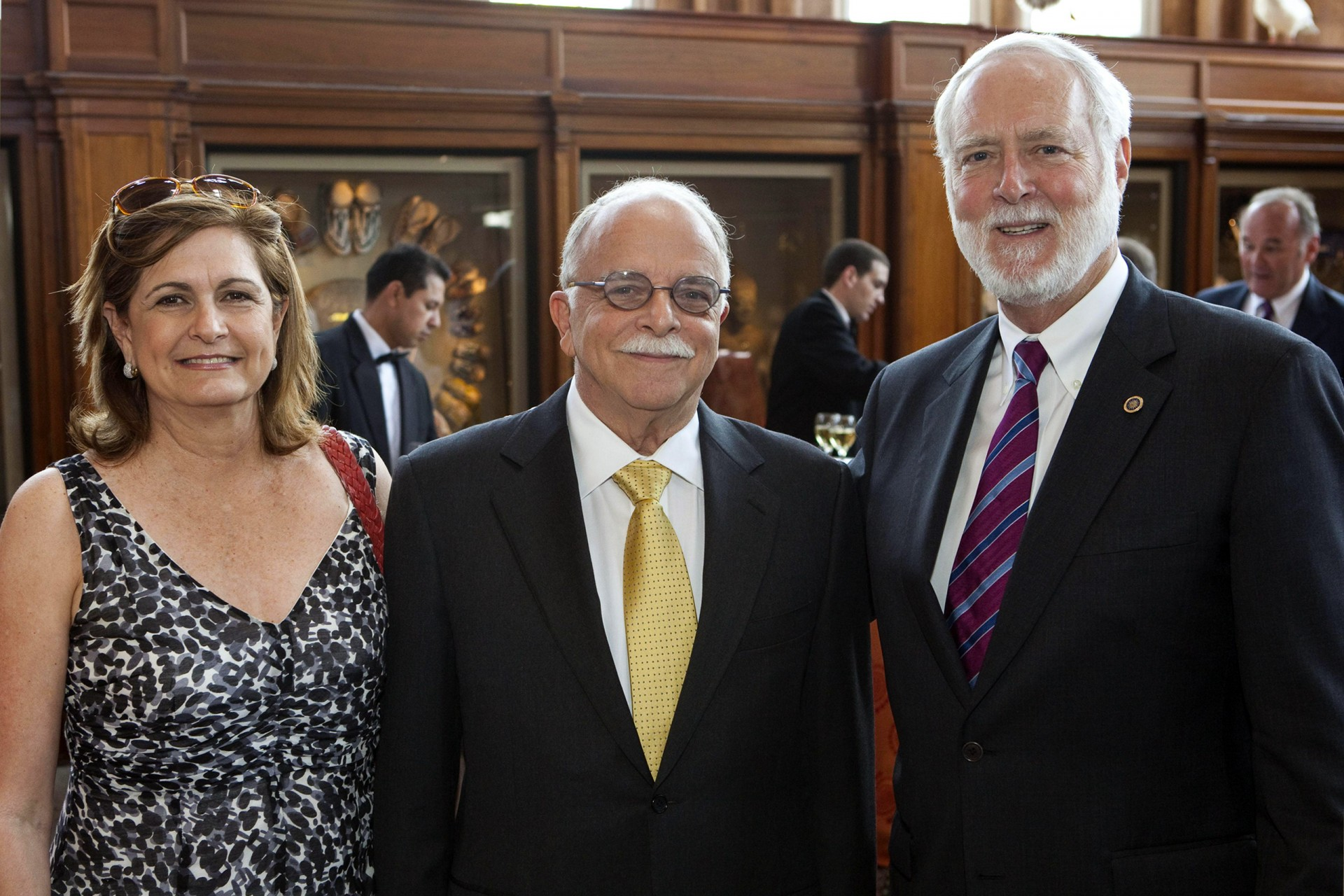 Ira Rubinoff, center, with his wife Anabella and Smithsonian Secretary Wayne Clough